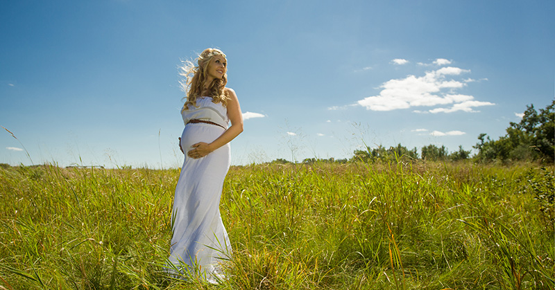 September Maternity Portrait in Prairie Grass at Sertoma Park in Sioux Falls
