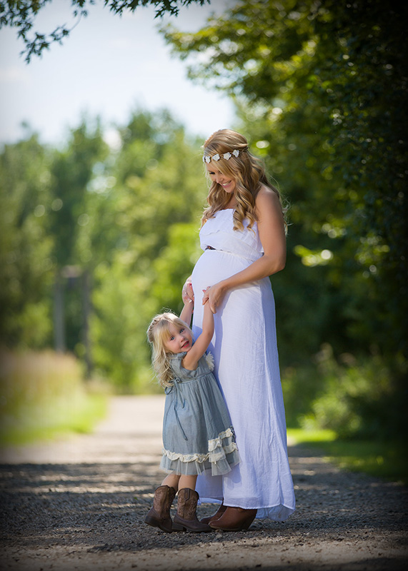Mother and daughter maternity portrait